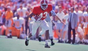 23 Sep 1989: Coach Bill Curry of the Alabama Crimson Tide walks onto the field with his players before a game against the Kentucky Wildcats at Legion Field in Birmingham, Alabama. Alabama won the game 15-7.